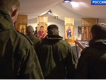 Ryska soldater firar jul i tältkyrka i Syrien.